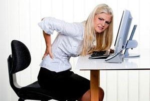 Female worker with pain in her back
