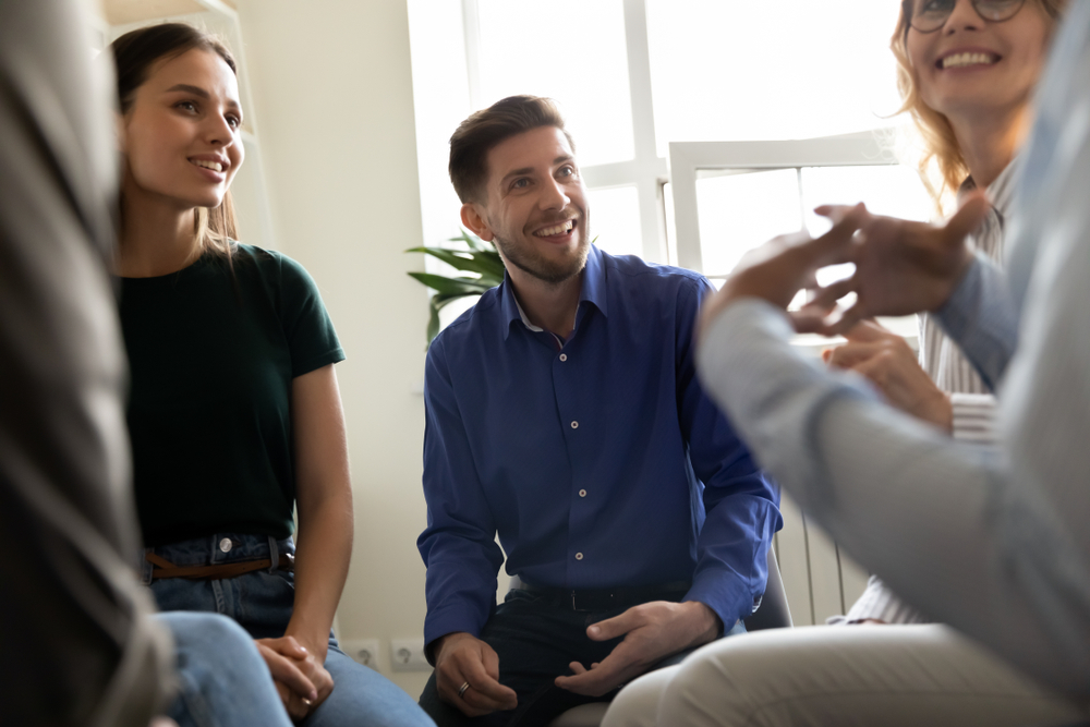 Group of people talking in a meeting