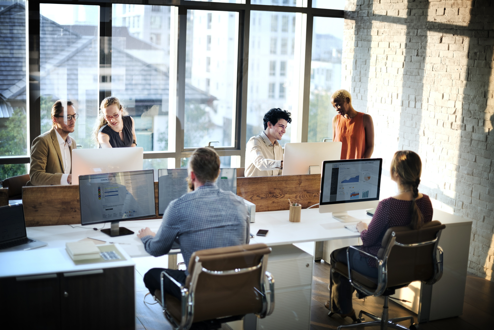 Group of staff in modern office working on computers