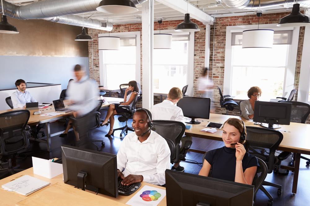 people sat in a modern office working
