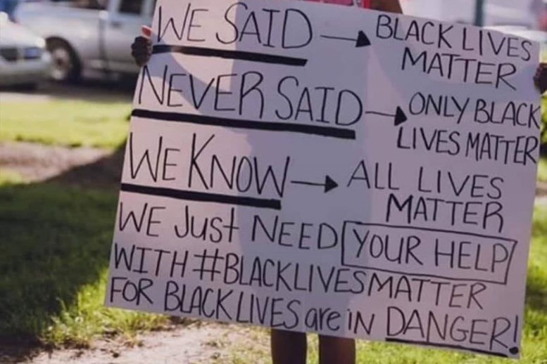 A young girl holding a home made Black Lives Matter sign