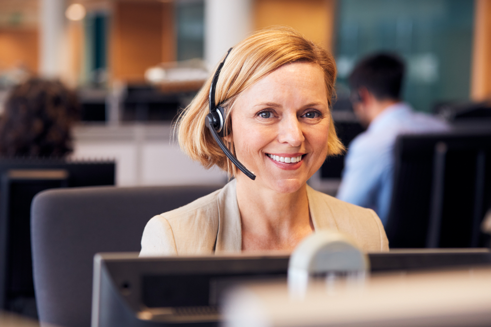 Female with headset on smiling