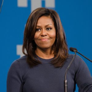 First Lady Michelle Obama next to microphones
