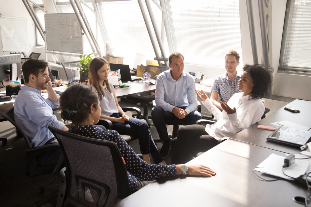 Group of staff talking in an office