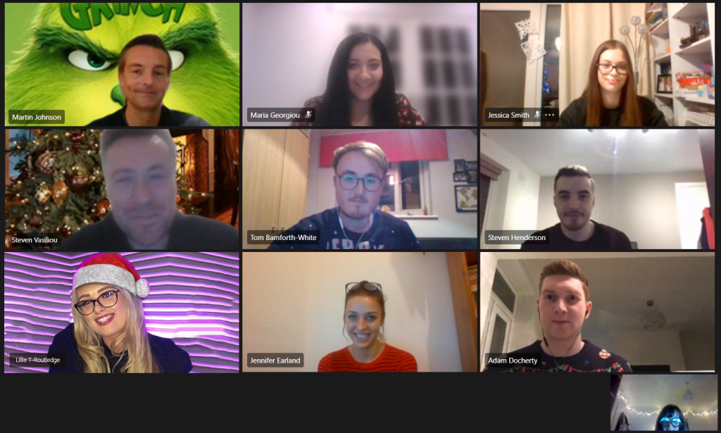 Nine people on a video call in christmas outfits