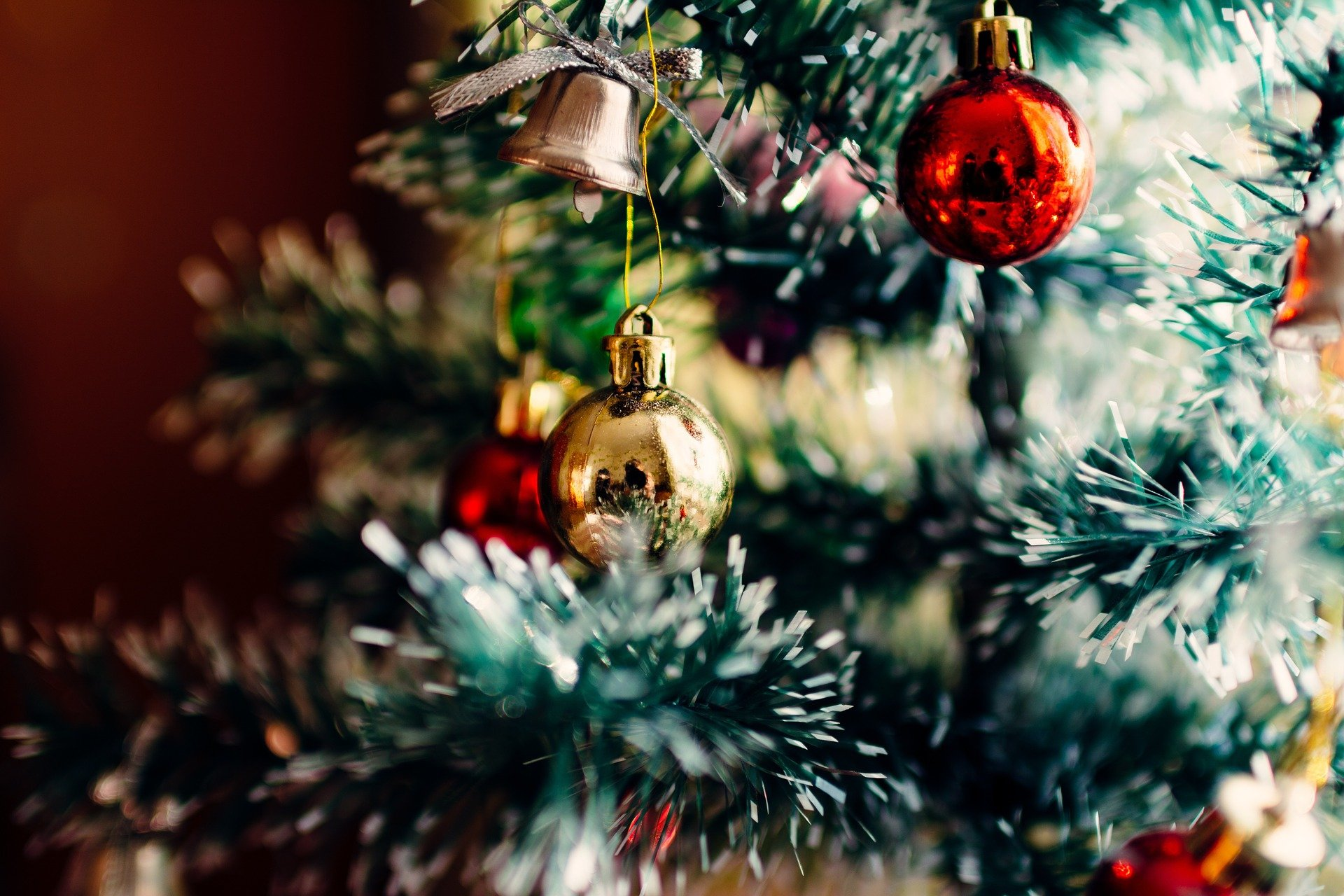 A close up of a christmas tree with baul bauls