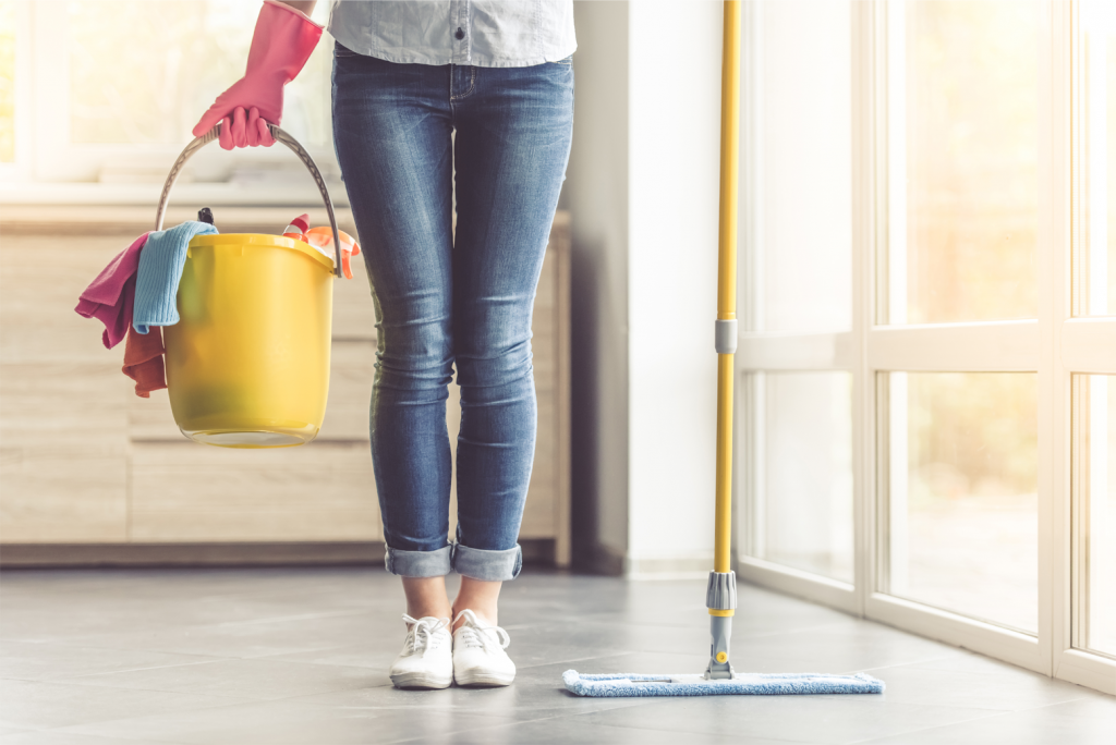 Woman standing with cleaning bucket