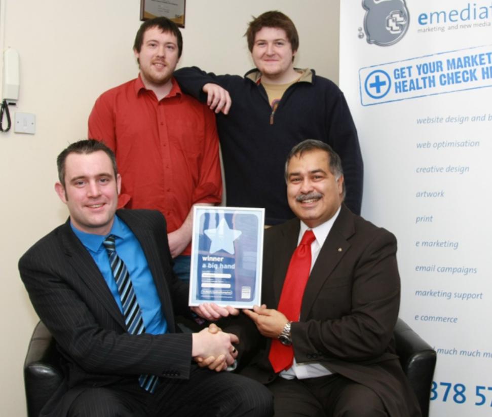 Anil winning Best of Wolverhampton Customer Excellence Awar