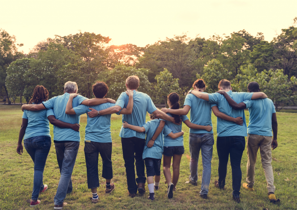 Group of volunteers walking together with arms around each other