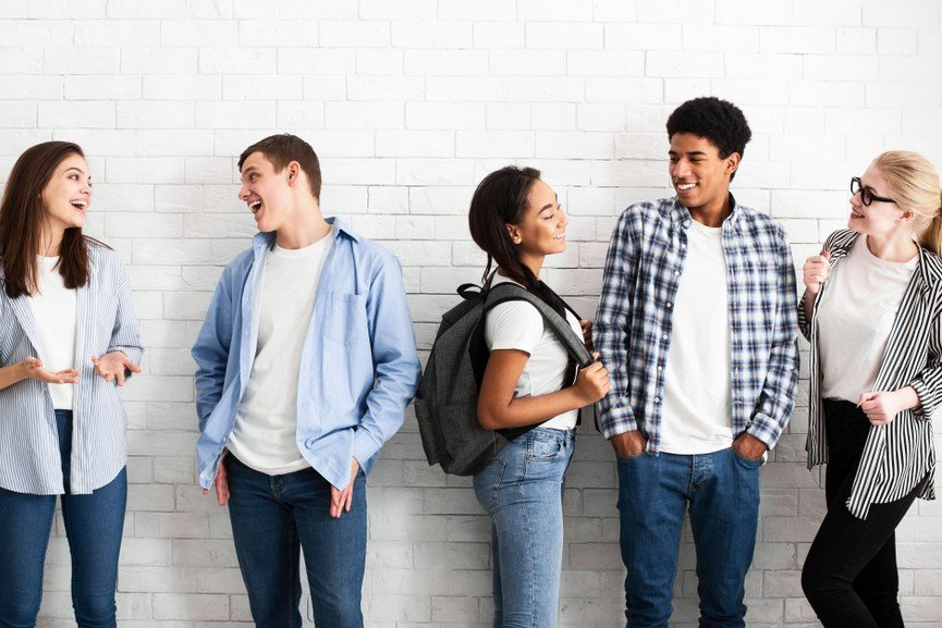 Young people smiling and talking