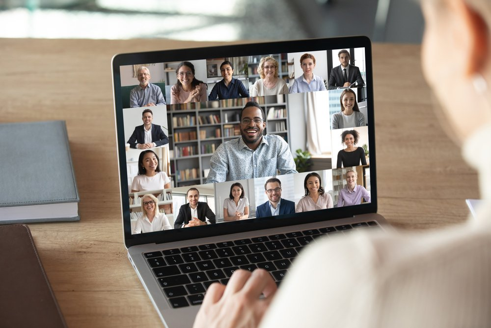 Female on a laptop video call with multiple work colleagues