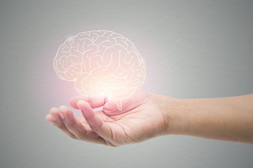 glowing brain in a hand